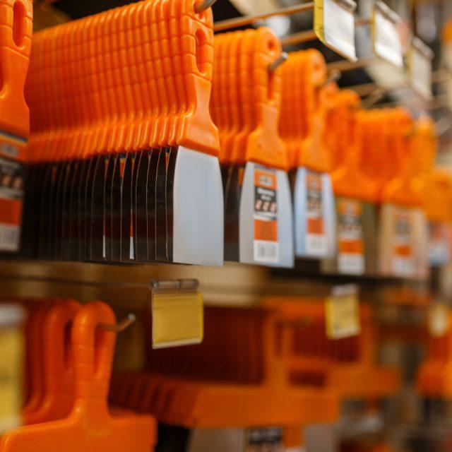 Hardware store assortment, shelf with instrument